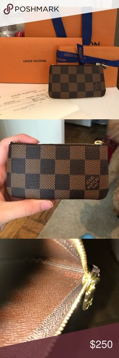 NWT Louis Vuitton Key Pouch Damier Ebene Barely worn. Rare on poshmark. Comes with everything you see. Louis Vuitton Bags Wallets