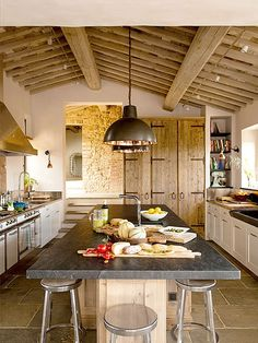 This ancient villa in Val d'Orcia, Tuscany has been renovated into a stylishly comfortable home. Incorporating the old stone, wood beams and bricks with new features, it has that wonderful rustic meet Luxury Villa Rentals, Tuscan House, Mediterranean Home Decor, Beautiful Kitchens, Beautiful Homes, Interior Design Kitchen, Kitchen Designs, Kitchen Dining, Kitchen Redo