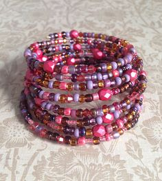 Memory Wire Bracelet in Shades of Coral, Amethyst, and Brown Glass Beads- Sweetheart Memory Wire Jewelry, Candy Jewelry, Memory Wire Bracelets, Seed Bead Jewelry, Handmade Bracelets, Jewelry Crafts, Beaded Bracelets, Wrap Bracelets, Handmade Jewelry