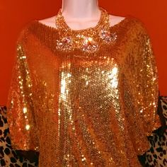 Glitzy Glam Blouse Designed with glittering gold sequins front and  comfortable  cotton solid color back pair with perfect for a night on the town can also be paired with your favorite skinny jeans for a wow effect Tops Blouses