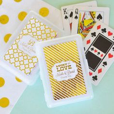 52 playing card decks packaged in white plastic cases with choice of gold or silver metallic foil labels personalized with choice of background pattern, wedding design and two lines of custom print.