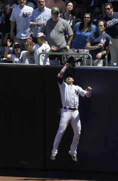 GAME 34: Sunday, May 13, 2012 - New York Yankees right fielder Nick Swisher catches a fly ball hit by Seattle Mariners' Dustin Ackley during the first inning of a baseball game at Yankee Stadium in New York. (AP Photo/Seth Wenig)