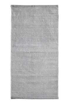 Patterned cotton rug: Rectangular rug in a cotton weave with an all-over print on the front.