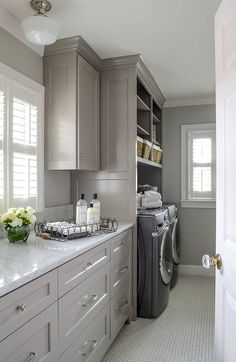 Laundry room. Front loading washer dryer, storage baskets for laundry detergent…
