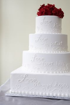 "This wedding cake features a Corinthians verse written on it: ""Love is patient, Love is kind..."". Cake # 051."