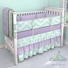 Crib bedding in Mint Large Quatrefoil, Lilac Osborne Damask, Solid Mint, Purple Dots, Solid Lilac, Mint Zippy Chevron. Created using the Nursery Designer® by Carousel Designs where you mix and match from hundreds of fabrics to create your own unique baby bedding. #carouseldesigns