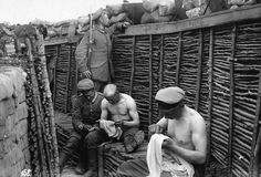 WW1: German soldiers, sitting in a well constructed trench, are picking lice from their clothes. This was a daily routine that brought no relief from the bests; they could destroyed only by BOILING the clothes for at least half hour.