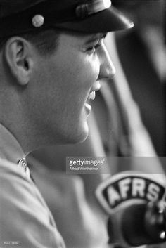 Alfred Wertheimer/Getty Images) At the New York Port of Embarkation's Brooklyn Army Terminal , American musician Elvis Presley laughs as he talks with Armed Forces Radio Service before he ships out , New York, New York, September 22, 1958.