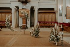 Beautiful floral decor at the church for the wedding ceremony | Image by Radu Benjamin