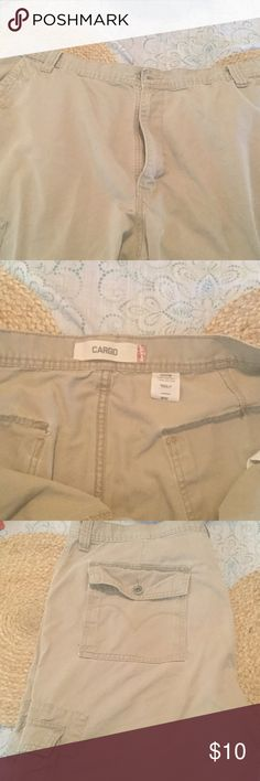 Used nice Levi cargo shorts Gently used mens Levi cargo shorts, only things that is missing is a back pocket button.  Otherwise comfortable Levi cargo shorts Levi's Shorts