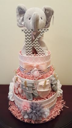Simply Showers - Pink and grey elephant diaper cake. Useful baby shower centerpiece gift. Regalo Baby Shower, Baby Shower Niño, Shower Bebe, Baby Shower Diapers, Girl Shower, Baby Shower Gifts, Baby Gifts, Baby Girl Elephant, Elephant Baby Showers