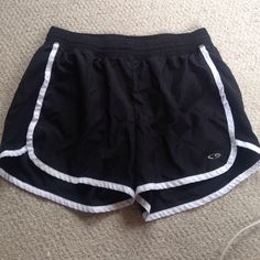 Black running workout shorts with white trim Look brand new, built in underwear and iPod holder, stretchy waste band Champion Shorts