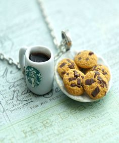 this necklace features a miniature plate of handmade chocolate chip cookies sculpted from polymer clay along with a cup of starbucks coffee charm. the ceramic