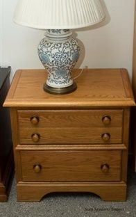 This is a two drawer night stand although it appears to have three drawers. Each drawer is large in size and they're interiors are in great condition. This kind of nightstand can also double as a living room end table. Visit our website for details and pricing information