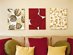 Love the idea of using fabric to decorate the walls and pull the colors from the pillows of different shapes.
