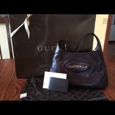 Gucci bag Only a few times used. Looks brand new. It comes with Gucci box, information book and price tag is still attach to storage bag. Gucci Bags Hobos