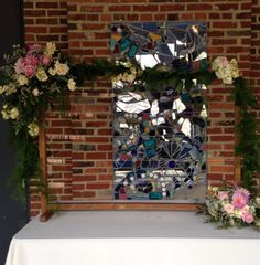 Clothes line wedding sign with floral garland Floral Impressions Hunt Valley, MD www.myfloralimpressions.com
