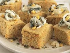 Classic corn bread gets a major flavor boost when it's topped with sautéed onions and poblano chiles blended with sour cream.