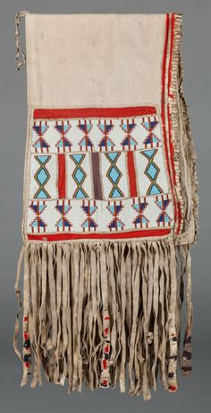 A NEZ PERCE OR BLACKFOOT BEADED HIDE DOUBLE SADDLE BAG. c. 1890