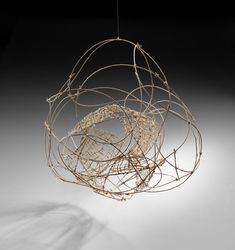"Nesting.Natural round reed and raffia. 37""hx28""wx22""d."