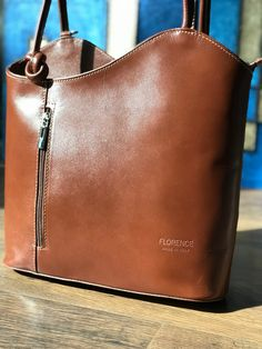 You will love this structured handbag made in Florence Italy. Carry over the shoulder or pull the straps outward to carry as a backpack for the handsfree option. The zip closure keeps your valuables secure. Inside and outside zip wall pockets. The wide bottom makes for a roomy bag. Comes in a variety of colors. #leatherhandbags #madeinitaly #pursesandhandbags #italianhandbags #fashionbackpacksbags #fashionbackpackspurse #shoulderbags #worktote #pursesandhandbagstotes How To Make Handbags, Purses And Handbags, Backpack Purse, Fashion Backpack, Structured Handbags, Italian Leather Handbags, Work Tote, Convertible Backpack, Wall Pockets