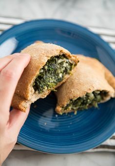 You can ditch the plate and fork for this version of spanakopita. The spinach and feta filling you know and love from this Greek dish is tucked inside whole-wheat pizza dough, then wrapped and baked into portable hand pies.
