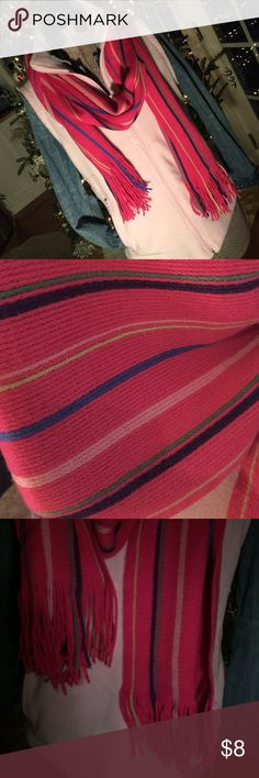 Knit scarf Pink knit scarf with fringed ends. Thin stripes of blue, green, navy, yellow and light pink. Like new condition. Like the fleece vest? Bundle and save. Accessories Scarves & Wraps