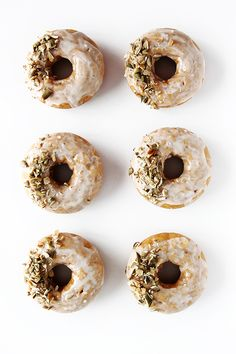 Baked Pumpkin Donuts coated in a thin glaze and sprinkled with pepitas. A fall treat with a little less guilt. Pumpkin Donut Recipe Baked, Baked Pumpkin, Donut Recipes, Pumpkin Recipes, Dessert Recipes, Fall Desserts, Drink Recipes, Baking Recipes, Thanksgiving Recipes