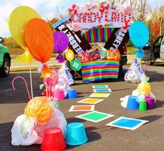 Candyland theme...use tablecloths for large lollipops. Buckets for gum drops.