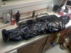 Trash bag corpse: Scary Halloween Decorating