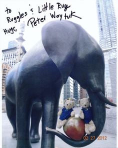 """In 2012, the famous sculptor Peter Woytuk (American, b 1958) held an outdoor exhibition in NYC, """"Peter Woytuk on Broadway."""" It began at Columbus Circle with the monumental, life-size """"Elephant Pair,"""" which Ruggles and Little Rug loved to visit.  They were very happy to meet Peter recently at the Morrison Gallery in Kent, CT (near Kuma's house in the woods).  They asked him to autograph a photo of them with his elephant, which he was happy to do."""