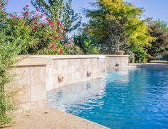 Beautiful pool with sheer decent water features, Pebble Tec. #masterpoolsofaustin #atlantisplastering #austinpoolbuilders #custompoolbuildersaustin #pools #pebbletec www.masterpoolsofaustin.com #masterpoolsguild