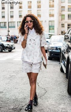 Womenswear Street Style by Ángel Robles. Fashion Photography from Milan Fashion Week. Delicate co-ord with platform sneakers with dots. On the street, Via Gaetano Negri, Milano.