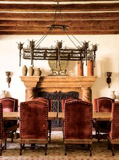The Moorish-influenced dining room seats 14 and features massive hand-hewed beams and intricate ironwork.