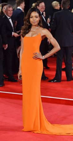 Naomie Harris looked SO. GOOD. in a bright orange Stella McCartney gown at the Spectre premiere