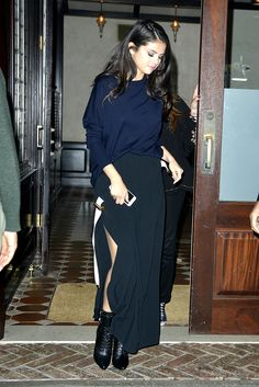 Selena manages to cover up and still look gorge in a navy top and long black skirt.    - Seventeen.com
