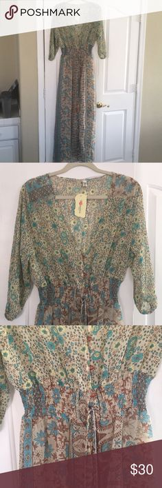 Boho hippie maxi dress NWT. Sheer maxi dress, 3/4 length sleeves. Size is xxlg but fits like a large. Sadly, too small for me. Polyester blend. Dresses Maxi