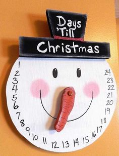 Paper Christmas Decorations - snowman face advent calendar in form of a wall hanging clock