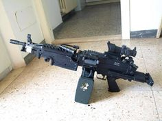 5.56mm M 249 (SAW) would love to have a team member with one of these when the zombies come