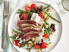 Grilled Tuna Over Green Bean, Tomato, and Chickpea Salad | We offer up 38 of our favorite fresh tuna recipes.