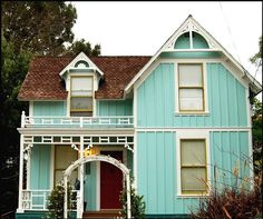 blue, shingle roof, yellowish window frames