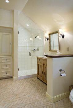 Glass shower, herringbone floors and raw wood vanity - I love all these elements!