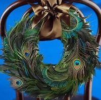 Peacock Wedding Bouquets   Peacock wreath! Beautiful brown ribbon.