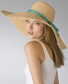 big straw sunhat with blue ribbon. I adore Big, floppy, wide brimmed hats - effortlessly glamorous but practical a country - chic at the same time.