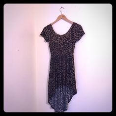 High-low leopard print babydoll dress size small Has a tiny hole near the back where the tag would be. Tags been torn out. Would fit a size XS-small. Listed f21 for visibility Forever 21 Dresses High Low