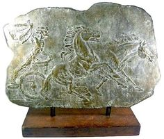 "George  Gach - ""Man in Chariot"" Art Deco Bronze Plaque, c.1950  17""H x 20""L on original wood base  Signed G. Gach  $1,800"