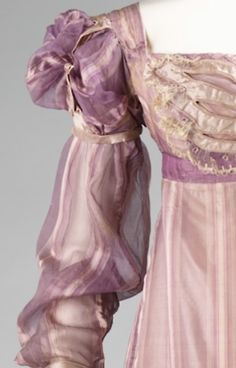 ca 1820, American, Silk. The Met: The puffed sleeves of this dress are an indication to the historicism in dress at the time. As a reinterpretation of 16th-century slashing, they make a statement about the Renaissance and the rebirth of artistic notions.