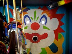 Historic merry-go-round at Santa Cruz Boardwalk  toss a brass ring into the clown's mouth
