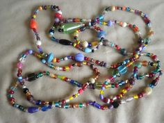 '385 Lampwork glass bead assortment ' is going up for auction at  7pm Tue, Jul 31 with a starting bid of $8.