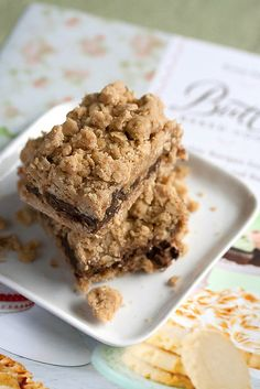 The Dunbar - oatmeal crumble bars filled with chocolate, coconut, pecans and dulce de leche (Bake Goods Ideas) Butter Bakery, Cookie Recipes, Dessert Recipes, Party Recipes, Brownie Bar, Dark Chocolate Chips, Christmas Desserts, Dessert Bars, Baked Goods